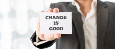 L'uomo d'affari Showing Card con cambiamento è buoni testi Fotografia Stock Libera da Diritti