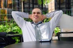 L'uomo d'affari si distende Fotografie Stock Libere da Diritti