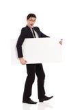 L'uomo d'affari sorpreso cammina con il cartello. Fotografie Stock Libere da Diritti