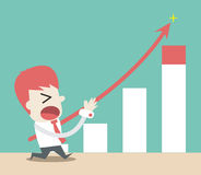 L'uomo d'affari spinge verso l'alto il grafico illustrazione di stock
