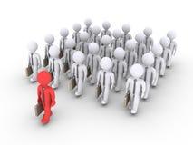 L'uomo d'affari sta conducendo un gruppo di altri uomini d'affari Immagini Stock Libere da Diritti