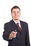 L'uomo d'affari sta fornendo il tasto dell'automobile Fotografie Stock Libere da Diritti