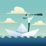 L'uomo d'affari sta navigando sulla barca di carta in oceano Fotografia Stock