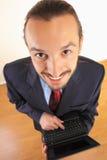 L'uomo d'affari tiene il computer portatile in mani Fotografia Stock Libera da Diritti