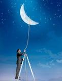 L'uomo d'affari vuole la luna Fotografie Stock Libere da Diritti