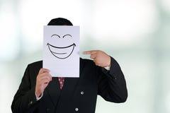 L'uomo d'affari Wearing Happy Laughing protezione la maschera Immagine Stock Libera da Diritti