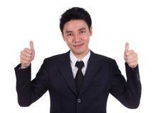 L'uomo di affari che mostra i pollici aumenta il gesto Immagini Stock