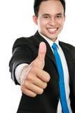 L'uomo di affari che mostra i pollici aumenta il segno Immagini Stock Libere da Diritti