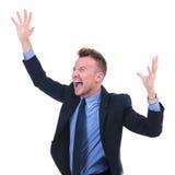 L'uomo di affari grida con le mani in aria Immagini Stock