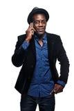 L'uomo di colore con il telefono Fotografia Stock