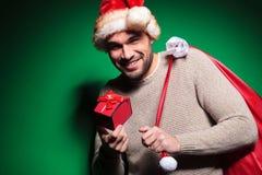 L'uomo di Santa dissapointed circa il suo piccolo presente Fotografia Stock Libera da Diritti