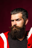 L'uomo di Santa piega le fronti Fotografie Stock