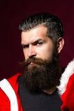 L'uomo di Santa piega le fronti Fotografia Stock Libera da Diritti