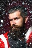 L'uomo di Santa piega le fronti Immagini Stock Libere da Diritti