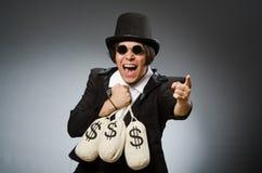 L'uomo divertente con i sacchi del dollaro Fotografia Stock Libera da Diritti
