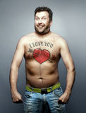 L'uomo divertente fa la dichiarazione di amore voi Fotografie Stock
