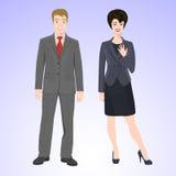 L'uomo e la donna sorridenti nello stile dell'ufficio durano Immagini Stock Libere da Diritti
