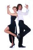 L'uomo e una donna si sono vestiti nel nero Fotografia Stock