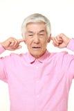 L'uomo giapponese senior soffre da rumore Immagine Stock Libera da Diritti