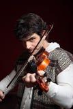 L'uomo gioca il suo violino Fotografie Stock