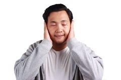 L'uomo ha coperto il suo orecchio immagini stock libere da diritti