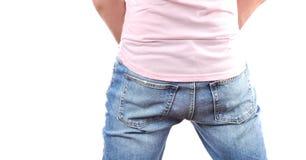 L'uomo in jeans dentro appoggia fotografie stock libere da diritti