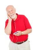 L'uomo maggiore ascolta MP3s Immagini Stock