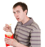 L'uomo mangia le patate fritte Immagine Stock Libera da Diritti