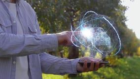 L'uomo mostra l'ologramma con Suv moderno stock footage