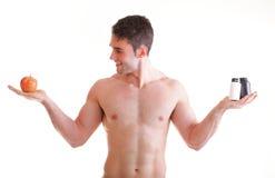 La vitamina o la compressa di resistenza delle pillole inscatola l'uomo di supplementi isolato Immagine Stock