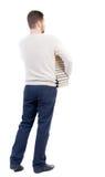 L'uomo porta un mucchio pesante dei libri Fotografia Stock