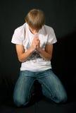 L'uomo prega per un perdono Fotografia Stock