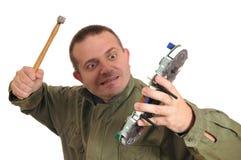 L'uomo rompe il cruscotto Fotografie Stock