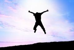 L'uomo salta al cielo Fotografia Stock Libera da Diritti