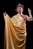 L'uomo si è vestito in dio greco Immagini Stock