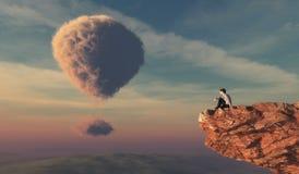 L'uomo si siede su una roccia Fotografia Stock