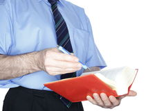 L'uomo sta leggendo Fotografie Stock Libere da Diritti