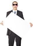 L'uomo tiene il manifesto. Immagine Stock Libera da Diritti