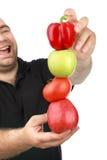 L'uomo tiene la frutta Fotografie Stock