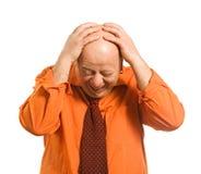 L'uomo in una camicia arancio Fotografia Stock