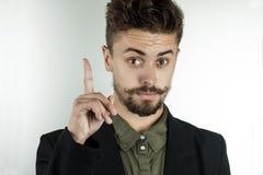 L'uomo in vestiti alla moda ha sostenuto un dito indice Fotografie Stock