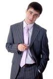 L'uomo in vestito con la penna in mani Fotografia Stock