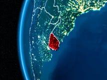 L'Uruguay sur terre la nuit Photographie stock libre de droits