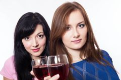 L women with glasses of wine Royalty Free Stock Photography