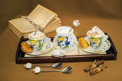 L wooden tray whit two cups of coffee, sugar and can Royalty Free Stock Photography