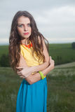 L young girl with long hair in field Royalty Free Stock Image