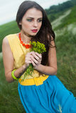L young girl with long hair in field Royalty Free Stock Photography
