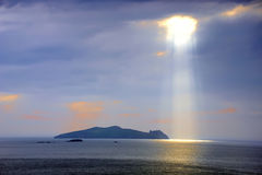 L1497 Sunlight. Sunlight breaks through clouds over Inishtooskert (Blasket Islands) on the Dingle Peninsula, Co.Kerry, Ireland Royalty Free Stock Photos
