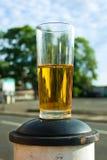 L5At vara hälften en öl på en stolpe i gatan Fotografering för Bildbyråer