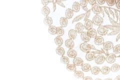Laço bege do close-up no fundo branco com espaço da cópia Imagens de Stock